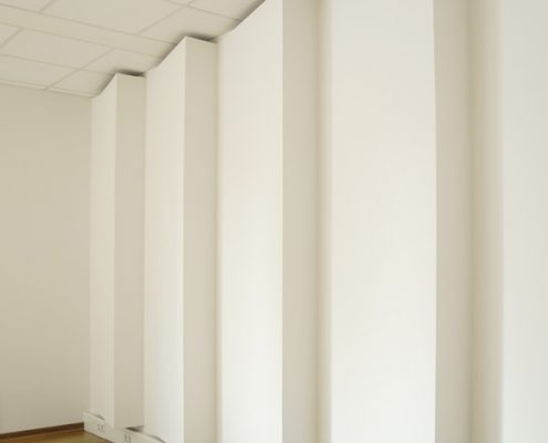 Acoustic wall cladding